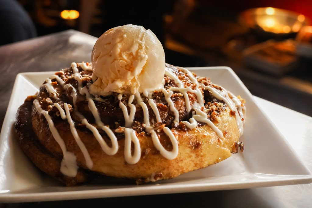 waffle with drizzle and ice cream on top