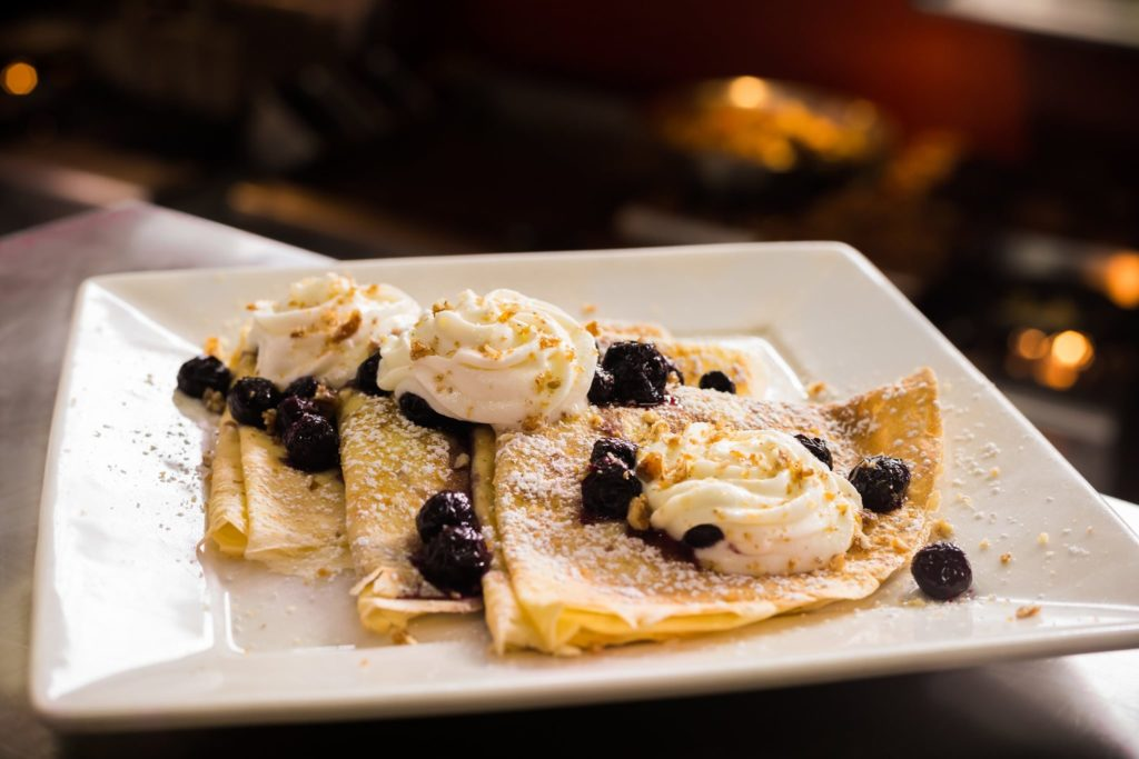 Crepes with whipped cream and chocolate